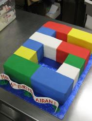 Lego theme sixth birthday cake in the shape of the number 6.JPG