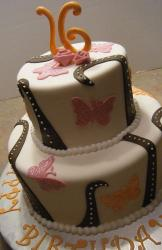 Two tier round white Sweet 16 birthday cake with butterflies.JPG