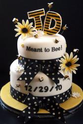 Two tier round white baby shower cake with birthdate and bees and flowers.JPG