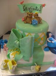 Dual tier green and white baby shower cake with teddy bear toppers and preganant woman and baby shoes and green bow.JPG