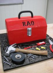 Red toolbox cake with hammer and other tools.JPG