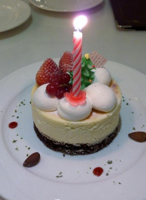 ... Dessert-size Birthday cake w/ strawberries & grapes atop of cheesecake