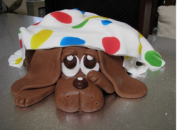 Adorable dog birthday cake with dog under blanket.PNG