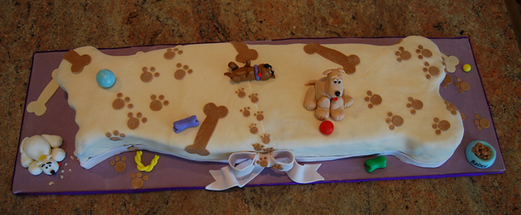 Big dog bone cake with great dog birthday cake themes.PNG