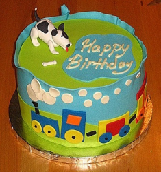 Cute dog cake with fun cake decor.PNG