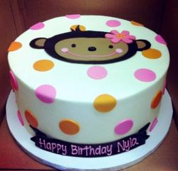 Pokadot Birthday Cake for Girl with Monkey face on top.JPG