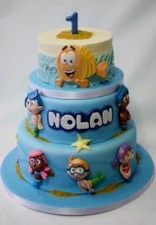 Bubble Guppies theme First Birthday Cake in 3 tiers.JPG