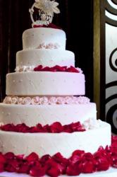 5 tier white round wedding cake red rose petals & pink roses bride groom topper with arch.JPG