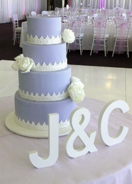 Lavender Wedding Cake In 4 Tiers With White Flowers Jpg