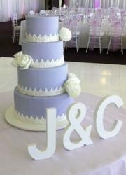 Lavender Wedding cake in 4 tiers with White Flowers.JPG