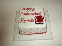 Modern graduation cake in white and red.jpg