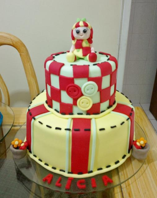 2 tier birthday cake for girl with checker pattern buttons & red stirpes.JPG