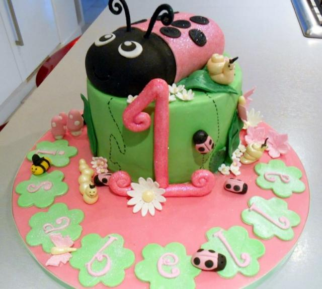 Picture of Pink ladybug birthday cake for one-year-old for baby girl