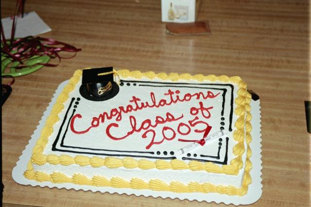 Retangle graduation cake with yellow and red.jpg