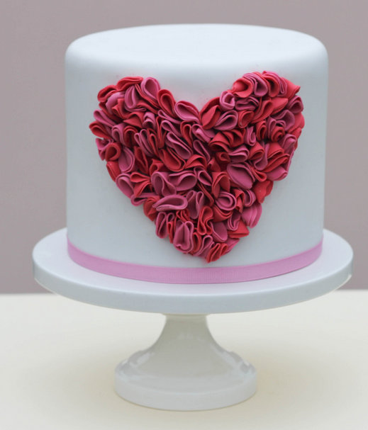 White chic valentine cakes with floral heart cake decor with pales patterns.PNG