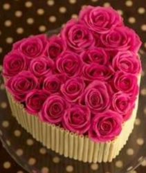 White chocolate valentine cake with hot pink roses cake decor.PNG