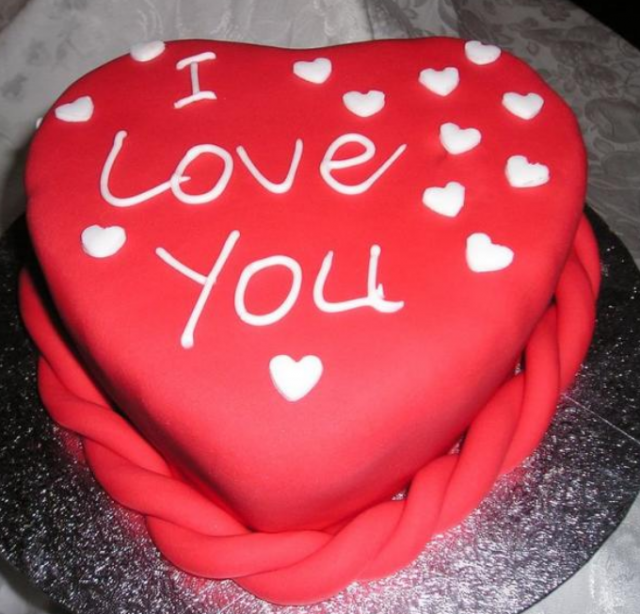 Heart Shaped Red Cake Images : Bright red cake with heart shaped valentine cake decors.PNG
