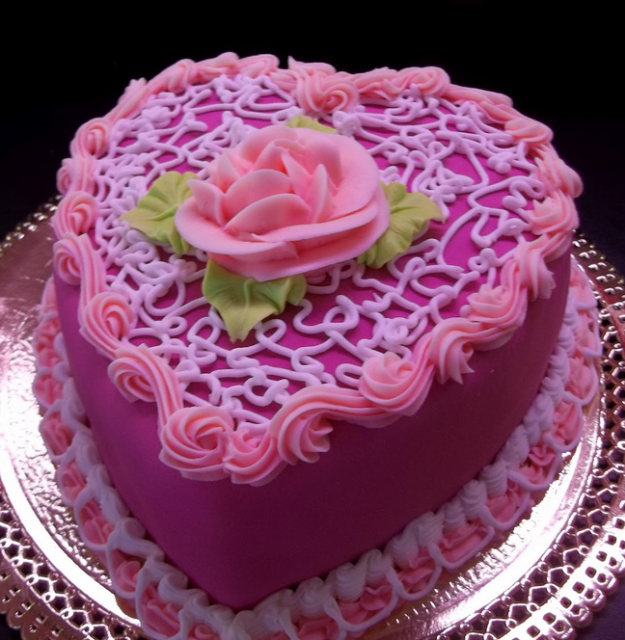 Hot pink heart shaped cakes with flowers cake decor.PNG