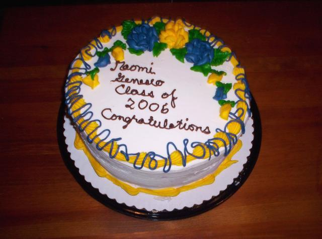 Round graduation cake with blue and yellow flowers.jpg