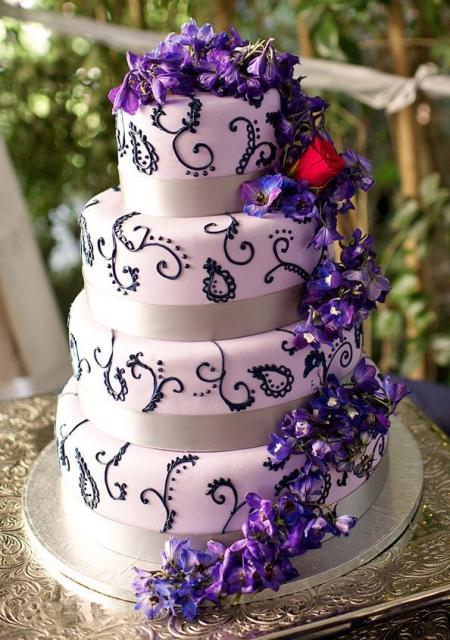 four tier wedding cake with flowers 4 tier pink wedding cake cascading purple flowers jpg 14436