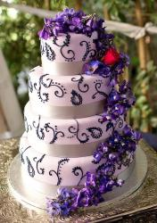 4 Tier Pink Wedding Cake Cascading Purple Flowers.JPG