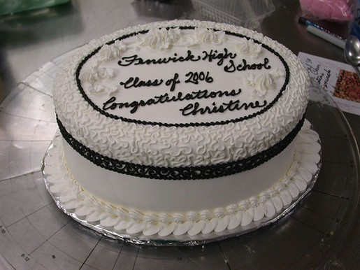 White and black color round graduation cake.jpg