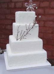white square wedding cake in four tier