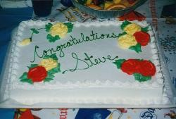 Big graduation cake with red and yellow roses.jpg