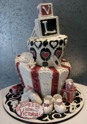 Multi-tier Topsy-turvy Baby Shower Cake with Blocks Pins Stripes Bottle & Booties.JPG