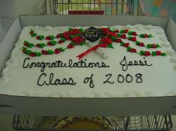 big square graduation cake with red roses.jpg
