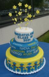blue white and yellow graduation cake with stars.jpg