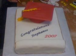 graduation cake with red graduation hat.jpg