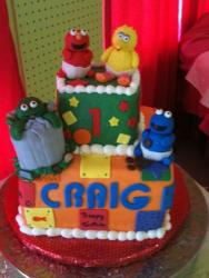 Two tier baby Sesame theme birthday cake for one year old.JPG