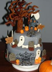 Two tier gray Halloween graveyard theme cake with ghosts and tree and haunted house.JPG