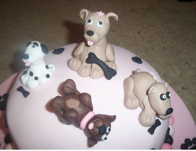 Pictures of Dog Cakes http://www.cakepicturegallery.com/v/dog-birthday+cakes-pictures-gallery/Dog+birthday+cake+toppers+pictures.PNG.html