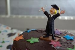 graduation cake guy on chocolate cake.jpg