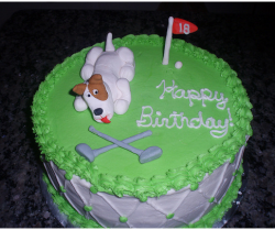 Dog birthday cake with golf course theme decor.PNG