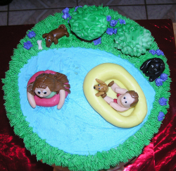 Dog birthday cake with pool, kids and two dos.PNG