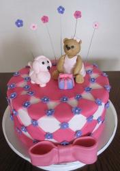Round pink birthday cake for girls with pink bow and teddy bear and poodle on top.JPG