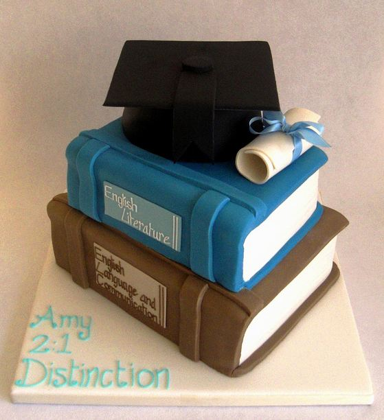 Two tier book theme graduation cake with black cap and white diplomma.JPG