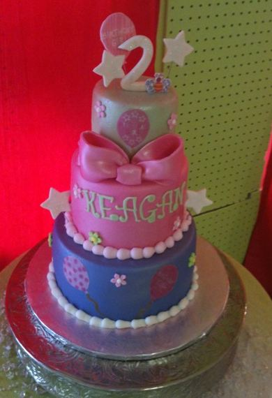 Three tier second birthday cake for girl with pink bow.JPG