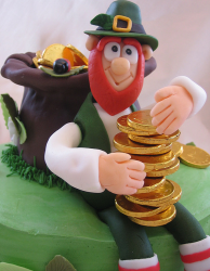 Very cool leprechaun cake topper with a man holding gold.PNG