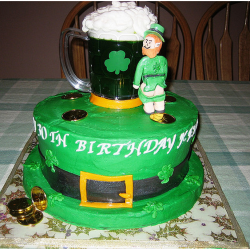Funny Irish birthday cake picture with St. Patrick's day theme with beer mug, gold, belt and naughty rish man taking of his pant