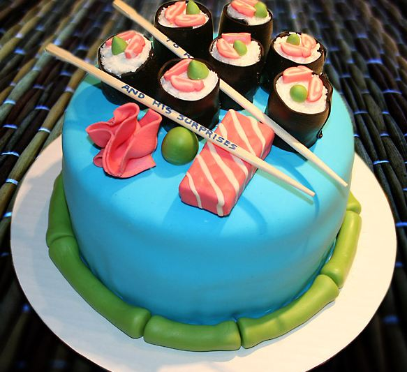Round blue cake with sushi and chopsticks on topJPG 1 comment