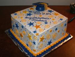 graduation cake with stars and graduation hat.jpg