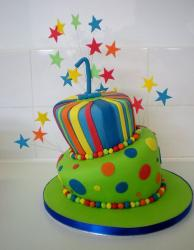 Two tier topsy turvy first birthday cake.JPG