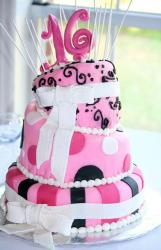 3 tier topsy turvy Sweet 16 pink birthday cake with white bows.JPG