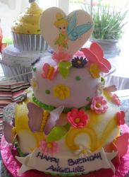 Two tier fairy and butterfly theme birthday cake.JPG