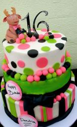 3 tier Sweet 16 birthday cake with the number 16 on top and pokadots and stripes and black bow.JPG