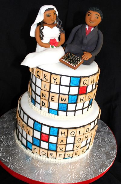 Two tier Scrabble theme wedding cake with bride and groom toppers.JPG
